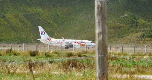 4k Airplane Falling Off Shangri-La Airport,YunNan China stock footage