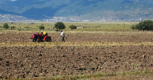 4k tibetan people use farm tractor Arable land in shangrila yunnan,china Footage