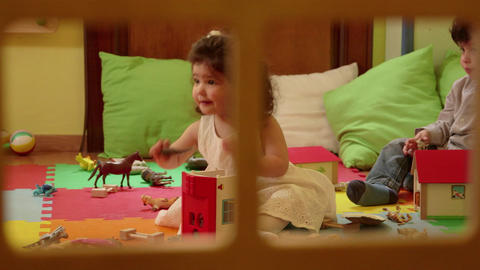 Baby Girl And Little Boy Playing With Toys At Preschool Footage