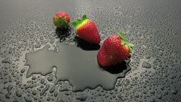 strawberry fruit falling on wet Footage