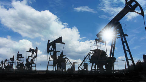 Working Oil Pumps Silhouette Against Timelapse Clo stock footage