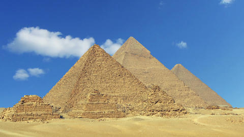 Clouds Over Great Pyramids In Egypt - Zoom In Time stock footage