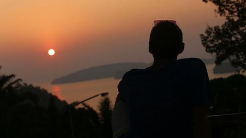 man admires sunset over sea Footage