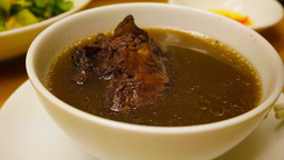 4k UHD time lapse video of eating black bean soup with pig trotters Footage
