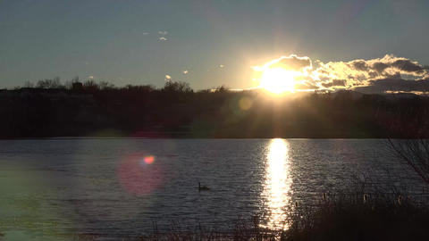 (timelapse) Sunset over Partial Frozen Lake Live Action