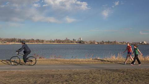 Bike Rider in front of Scenic Lake Live Action