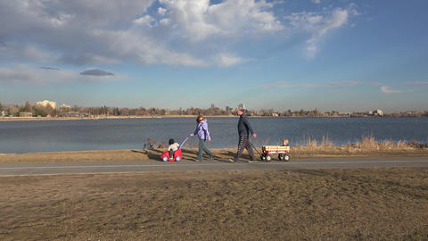 Family Walking Past A Lake stock footage