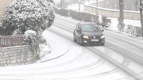 Snowy road in a little village Footage