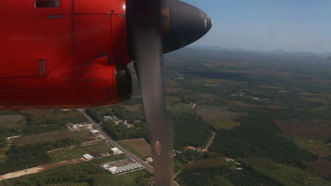 rotation of airplane propeller flying above tropic Footage
