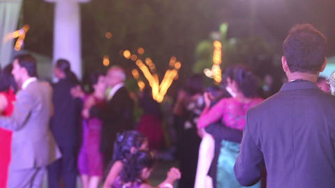 people dance at wedding party Live Action
