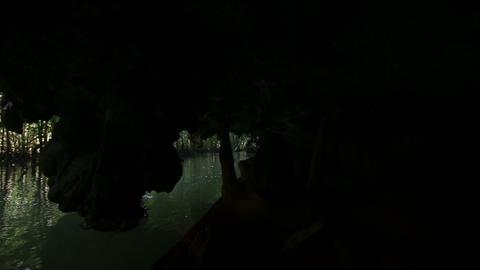 elder tanned man floating in canoe Footage