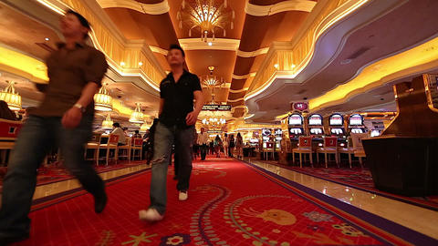 2 angles - people walking the wynn casino hotel re Footage