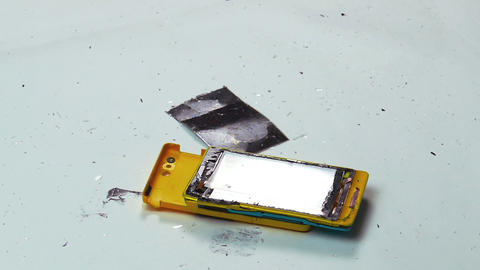 Destruction of a Cell Phone with a Hammer Footage