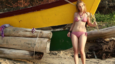 blonde girl in swimsuit poses near boat Footage