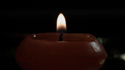 [ungraded] Candle Close-Up On Black Background stock footage