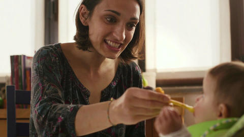 Mom Giving Food To Little Child At Home stock footage