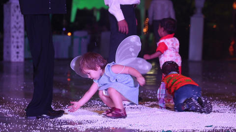 little child wearing butterfly wings play at weddi Footage