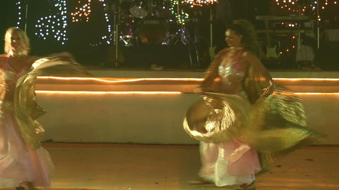 two young girls in theatrical costumes dance Footage