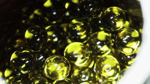 Balls Of Fish Oil In Can stock footage