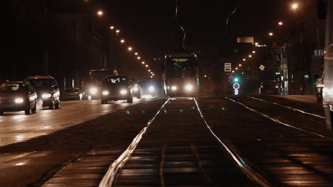 Ungraded: Tram Rides Through Winter Night Street Slowly Approaching The Footage