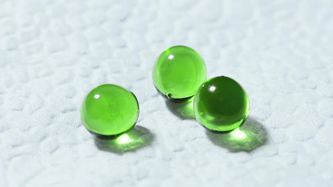 Three Green Transparent Tablets Rotate On White Background stock footage