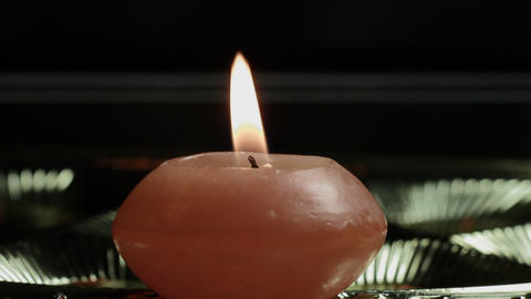 1080p Ungraded: Candle Close-Up on Shiny Background Live Action