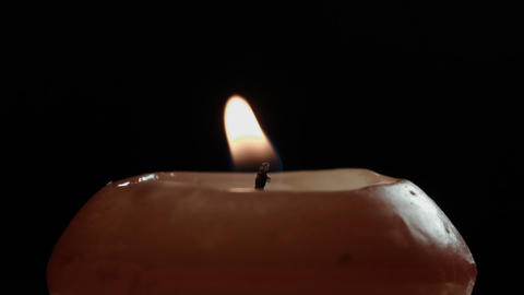 Ungraded: Candle Close-Up On Black Background stock footage