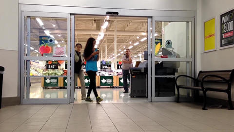 Shopper walking through the main entrance at super Footage