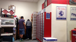 People choosing empty box for mail inside post off Footage