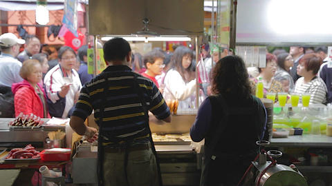 Ningxia night market - staff a cane sugar drink -  Live Action
