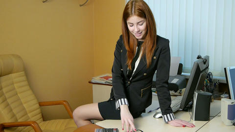 Young woman secretary at work at the office Footage