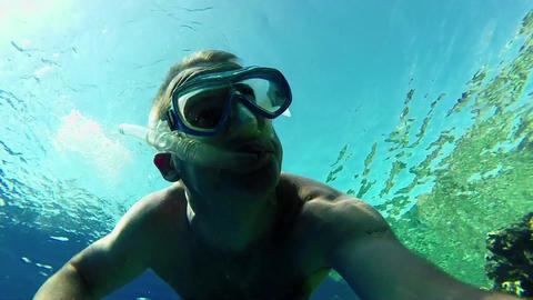 Man Swimming And Snorkeling Near Coral Reef In Red stock footage