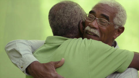 Old African American Friends Meeting And Hugging Footage