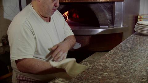 Man Working Cook Making Pizza In Italian Restauran stock footage