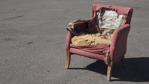 Retro Ragged Armchair Outside On Asphalt stock footage