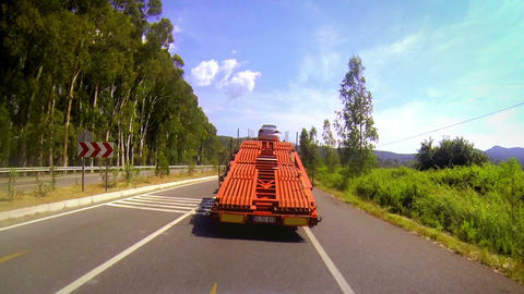 Following a truck car trailer in car Footage