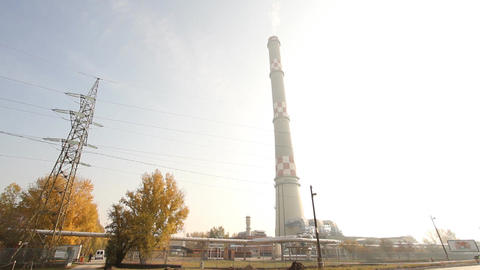 Industrial Suburban Area 06 factory tower haze Pan left Stock Video Footage