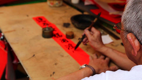 Man Writing Chinese At Chinese New Year Market - O stock footage