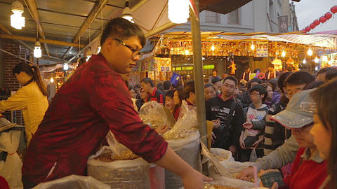 Taiwan market - man serves assorted nuts Live Action