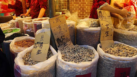 Taiwan market - different bags of dried peanuts Footage