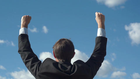 Male Businessman Back Raising Victory Arms Footage