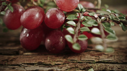 A Bunch Of Grapes With A Rustic Background HD Stock Footage stock footage
