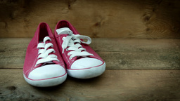 A pair of red leisure shoes HD stock footage Footage