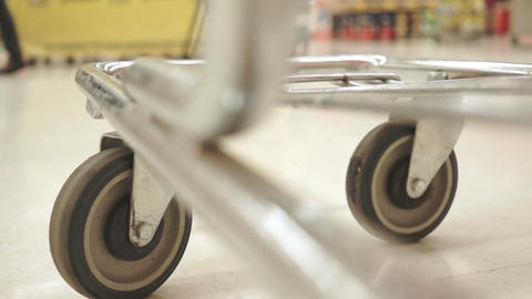 Shopping Cart Low Angle Both Wheels Fast Footage