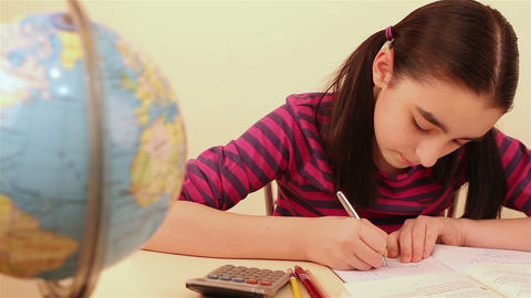 Schoolgirl Doing Her Homework stock footage