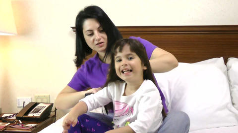 Woman brushing her daughter hair at home Footage