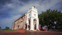 Young couple in front of St. Paul's Church in Melaka, Malaysia, Asia Footage