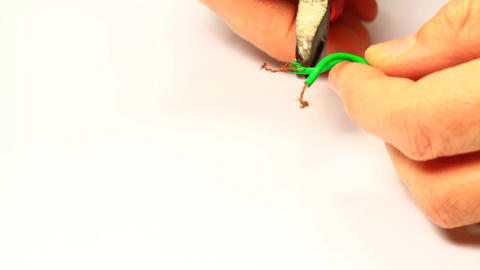 Electrician cutting the cable end using a stripper Footage
