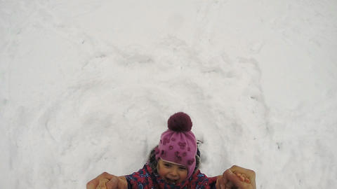 Happy Child Rotates And Fall On The Snow stock footage