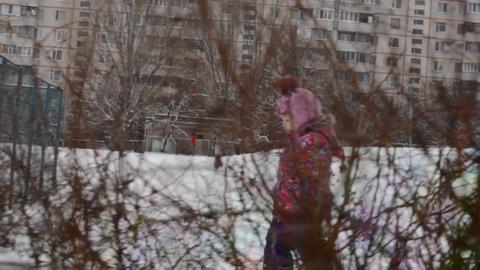 Little girl walking through the bush Footage